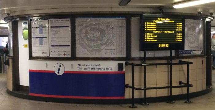Rotunda in Leicester Square station ticket hall in 2019. A map, and information displays.